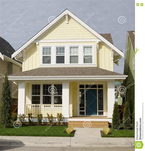 houses with yellow siding yellow home house exterior siding stock photo image