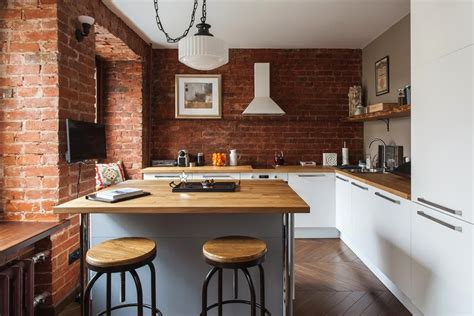 Oak Cabinets Kitchen Design studio apartment stays authentic by keeping its brick