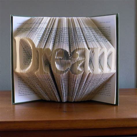 Fold Paper Into Book - beautiful typographic book sculptures created with folded