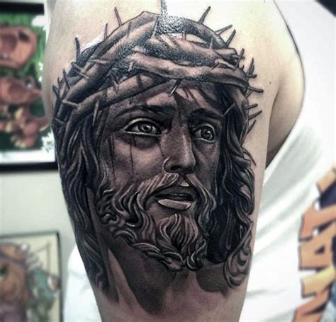 jesus tattoo on arm facebook jesus face male upper arm tattoo with black and grey ink