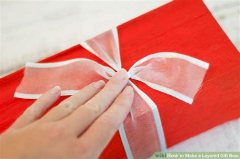 How To Make A Paper Present Bow - how to make a layered gift bow 9 steps with pictures