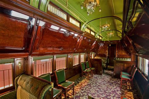 history  private pullman train cars curbed