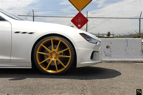 black and gold maserati wald maserati ghibli black di forza bm12 savini wheels