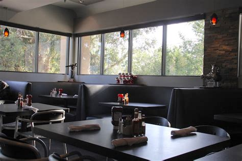 newspaper themed restaurant hozy s grill the finest dining at an automotive themed