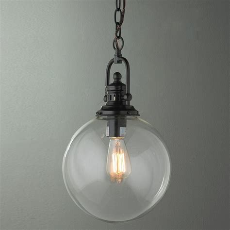 Industrial Glass Pendant Lights Clear Glass Globe Industrial Pendant 2 Finishes Pendant Lighting By Shades Of Light