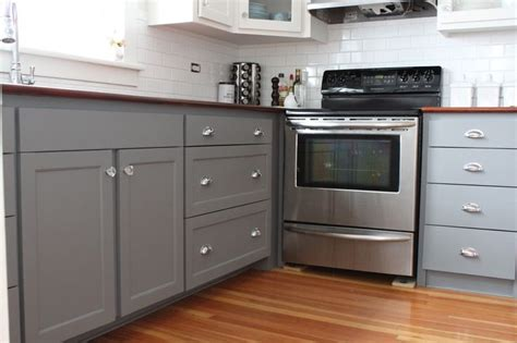 gray base cabinets with white countertops gray lower drawers white upper cabinets butcher