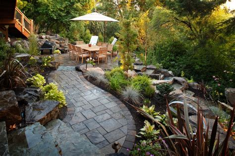 Patio Designs On A Slope Lush Garden And Gray Patio Alderwood Landscaping