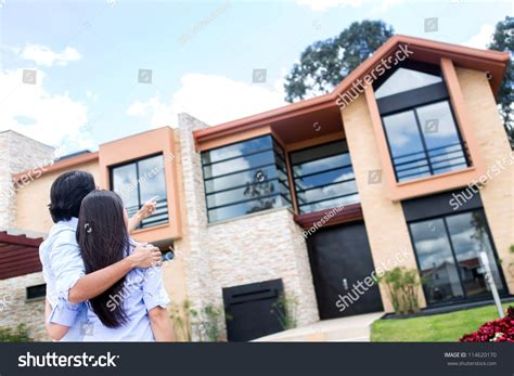 look for houses to buy couple looking beautiful house buy stock photo 114620170 shutterstock