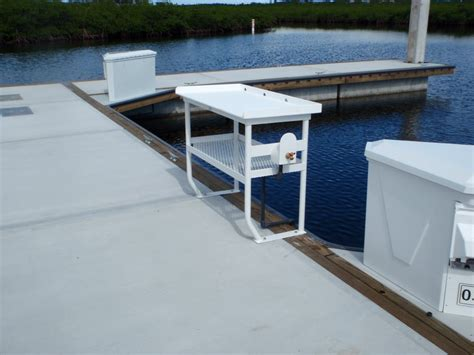 fish cleaning tables on floating docks in reef