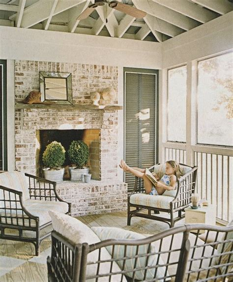 screened in porch with a fireplace for my back deck