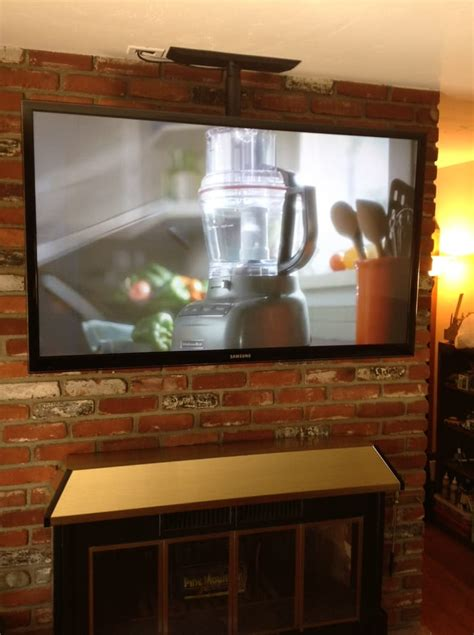 Flat Screen Tv Above Fireplace by Creative Installation Large Flat Panel Tv Floating