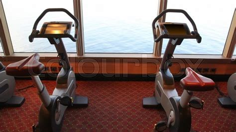 electric boat job training exercise bicycles in gym of cruise ship stock video