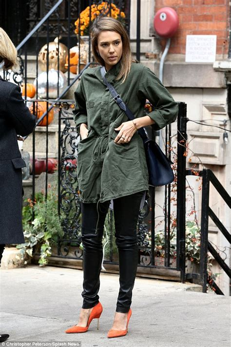 Orange you glad i wore leather jessica alba stands out on nyc street
