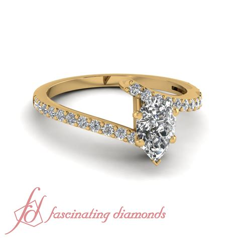 pave set yellow gold handmade engagement ring with pear