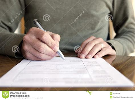 writing on paper writing on paper with pen on table stock photo image