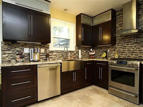 black brown kitchen cabinets traditional kitchens with warm brown wood cabinets