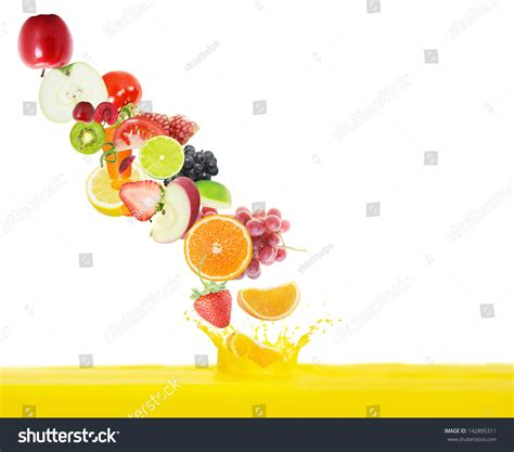 background juice fresh juice pours from fruits on a white background stock