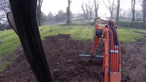 Landscape Rake Mini Digger Kubota U25 3 Mini Digger Excavator Using A Rake