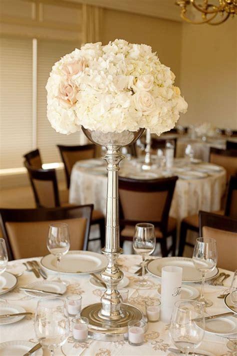 tall wedding flower centerpiece with hydrangeas
