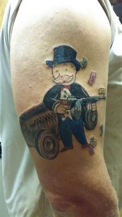 monopoly tattoo designs monopoly gun start to a half sleeve