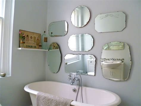 retro bathroom mirror how to hang a display of vintage mirrors decorator s