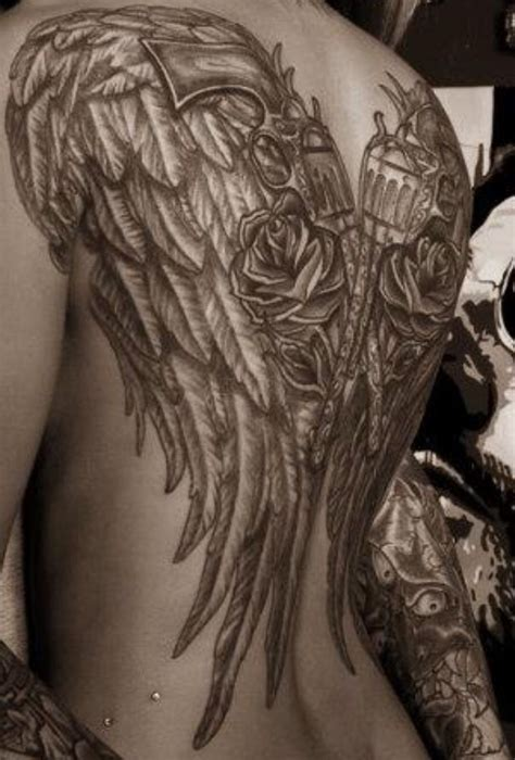 angel wing tattoo on back wings tattoos and piercings