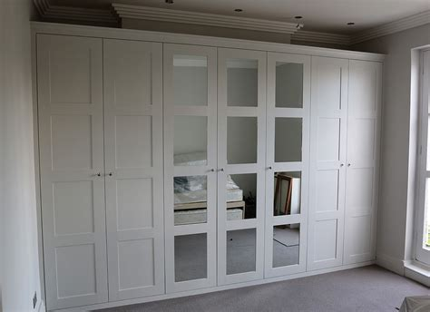 bedroom mirrored wardrobes fitted wardrobes bookcases shelving floating shelves