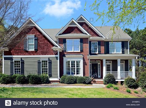 Two Story House the front of a two story house with brick and siding in