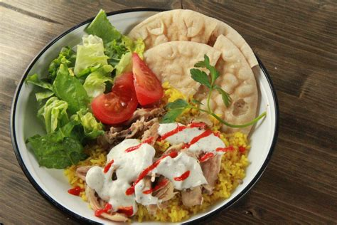 chicken and rice food halal guys chicken and rice cooks the world
