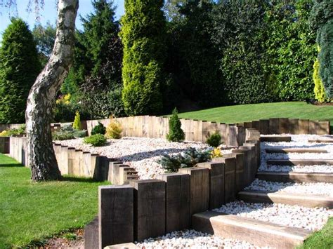 Garden Design Using Sleepers by How To Build A Retaining Wall With Railway Sleepers