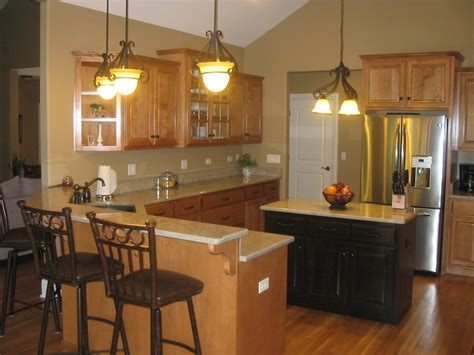 Oak cabinets, espresso stained island cabinets, light tan