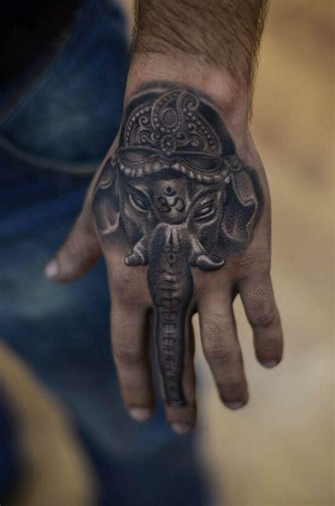 ganesha tattoo on hand ganesha by oleg kolomiets at kolomiets tattoo in