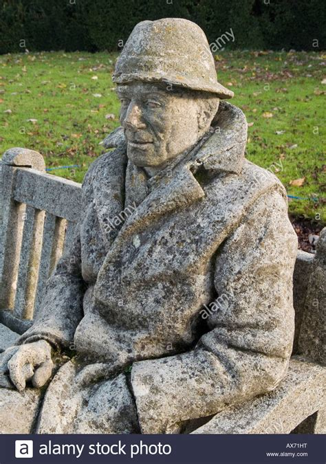 man made stone bench tops a stone man sitting on a stone bench in the gardens at