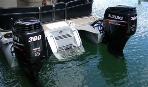 luxury inboard pontoon boats miami debuts by honda marine mercury racing and premier