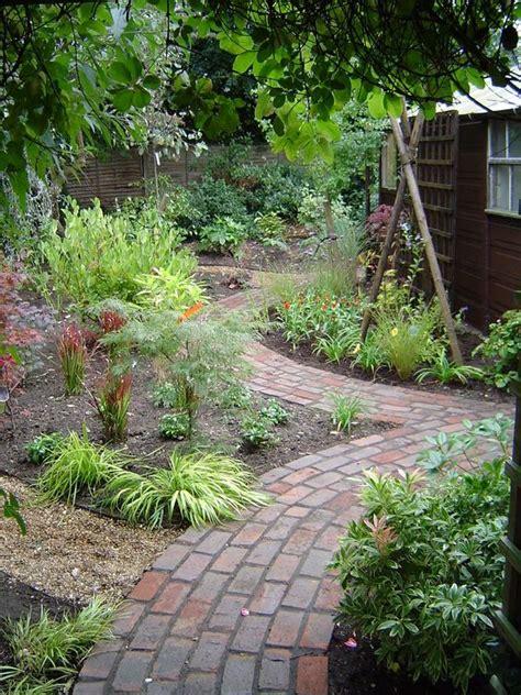 Winding Path Gardens by Traditional Brick Path Winding Through Woodland Garden