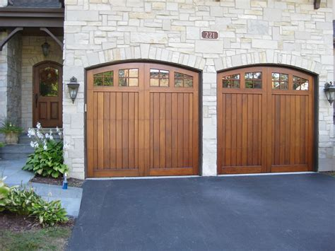 Wood Looking Garage Doors Deciding On Refinishing Wood Garage Doors The Look Or The Wow Look Painting In Partnership