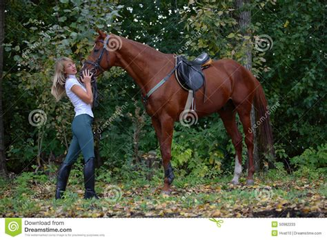 commercial girl riding horse joyful girl riding horse in forest stock image image