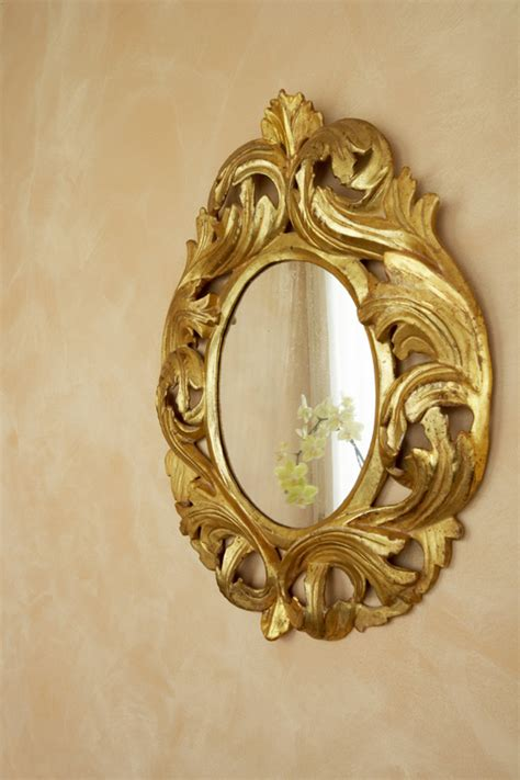 doratura cornici applicazione foglia oro su legno doratura su parete