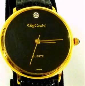 Oleg cassini gold black leather 70