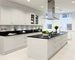 Mid sized elegant enclosed kitchen photo in london with shaker