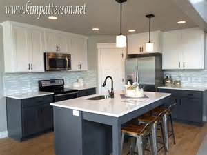 gray kitchen with white cabinets kitchen antique white cabinets with black appliances 2