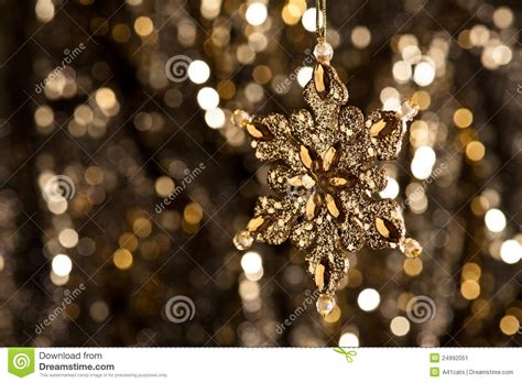 artificial snowflake  gold  glitter background stock