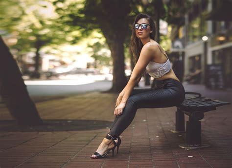 girls bench women sitting bench street high heels sunglasses