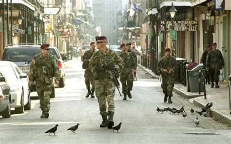 Building Contractors Near Me by Bourbon Street New Orleans 82nd Airborne Troops Patrol