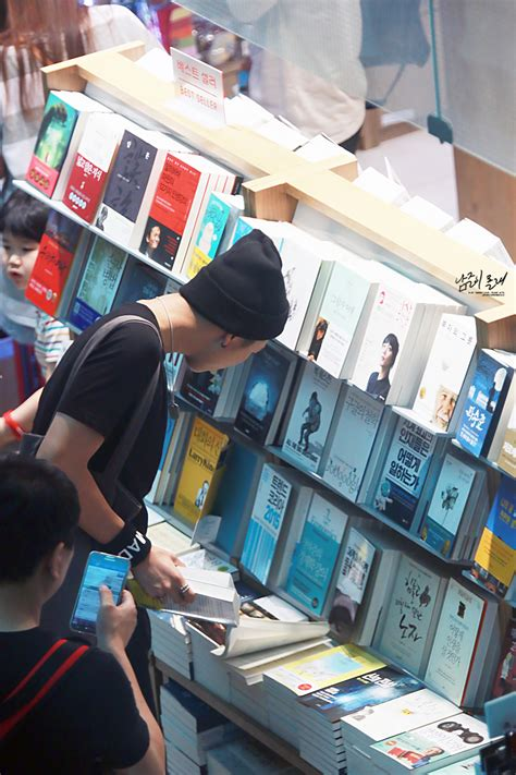 kim namjoon books picture fansitesnap bts at incheon airport depart to
