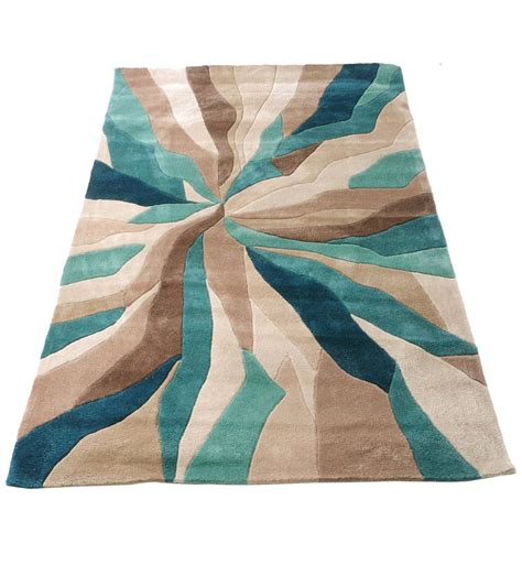 and teal rugs nebula rug in beige teal blue and brown neat stuff teal blue teal and beige