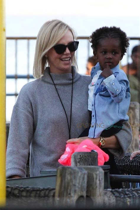 charlize theron has a family fun day at the pier growing