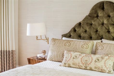 elegant master bedroom with upholstered green headboard