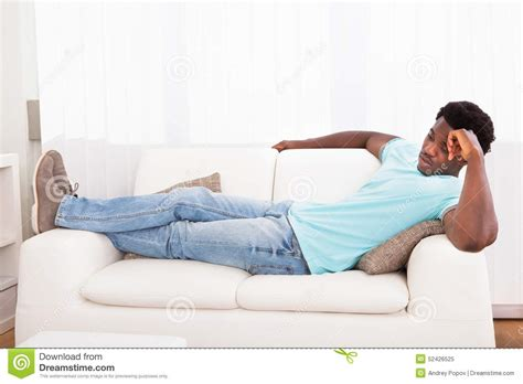 lazy on couch lazy man chilling out on sofa stock photo image 52426525