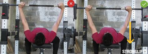 lower back pain bench press how to bench press with proper form the definitive guide